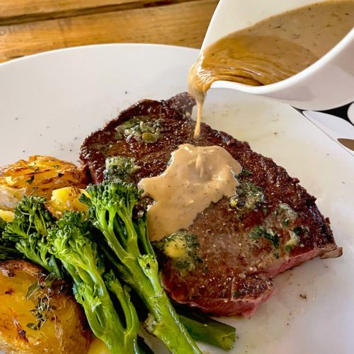 Peppercorn sauce served with sirloin steak